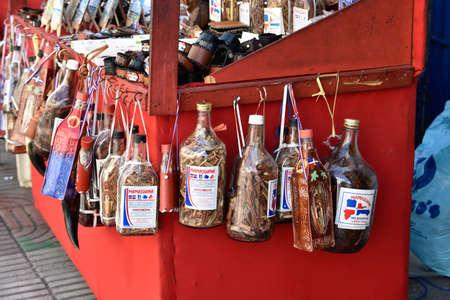 Santo Domingo, Dominican Republic. Dominican alcoholic liquor, called Mamajuana, sold as souvenirs.