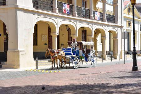 conde: Santo Domingo, Dominican Republic. A man driving a horse-drawn carriage in the Colonial Zok.ne near the Columbus Par