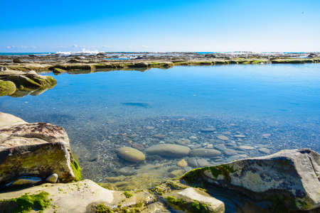 Beautiful landscape, seascape, amazing nature background with rocks and blue water. Stock Photo