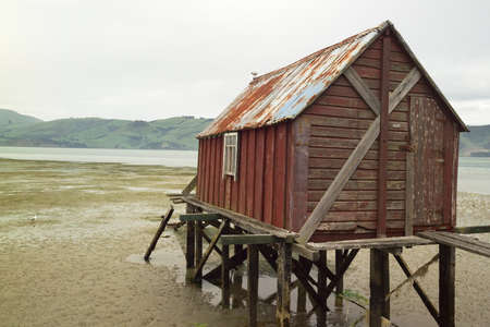boathouse: boathouse in tide, low  Stock Photo