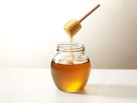 Warm honey in a stick