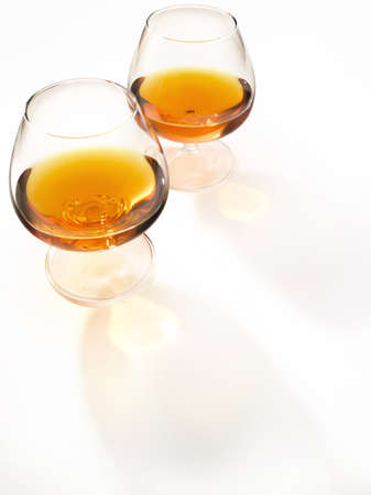 Glass of cognac in a light environment