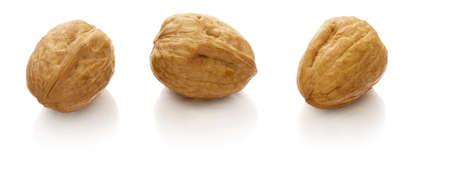 reflaction: walnut on white with reflaction Stock Photo