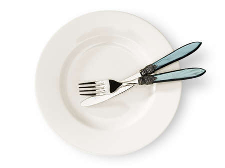 A light ceramic plate with cutlery