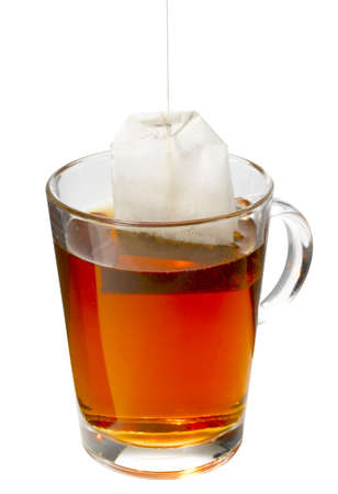 Teabag hanging in an cup of tea.