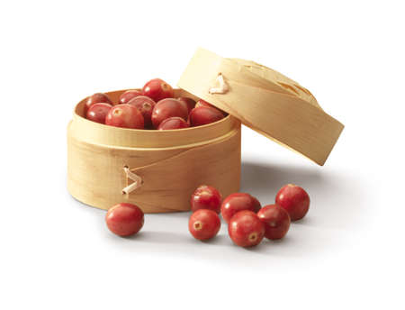 Little wooden box filled with cranberries. Stock Photo