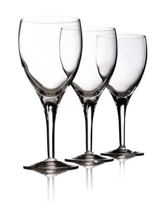 Red wine devided in three elegant wine glasses Stock Photo - 10943136