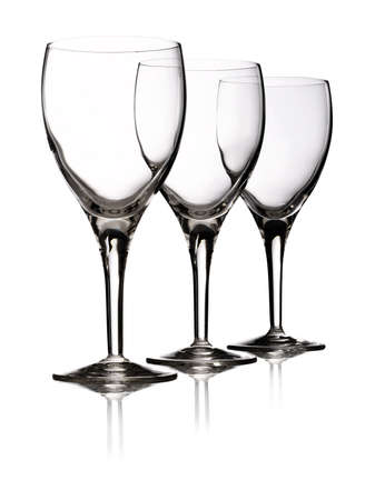 Red wine devided in three elegant wine glasses Stock Photo - 10943136