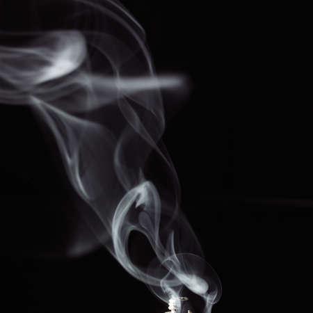 white smoke against a black background photo