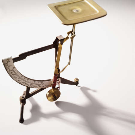 grams: Antique letter balance on a white desk