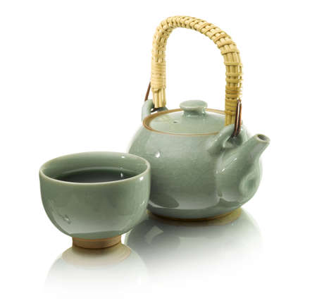 green tea in a green tea pot on whit background japanees style