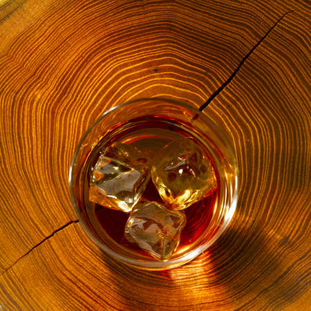 Whiskey on the rocks and on wood photo