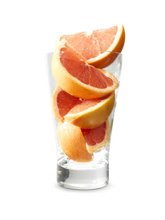 Grapefruit parts in a glass isolated on white.  Clipping path included in the file!