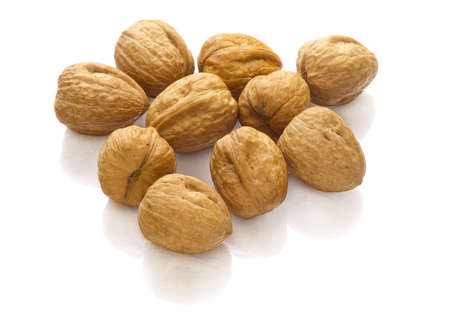 reflaction: group of walnuts on white with reflaction