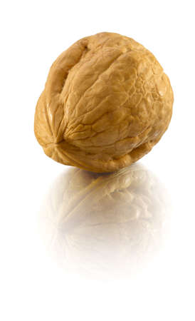 reflaction: walnut in nutshell on white with reflaction Stock Photo