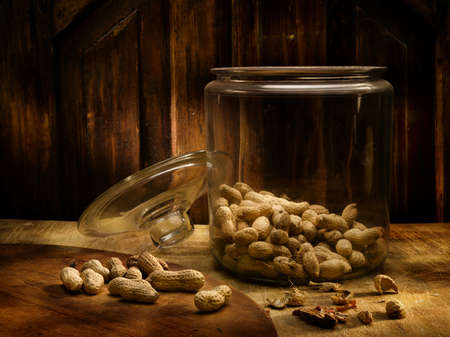 Peanuts in a pot of glass in an antique environment photo