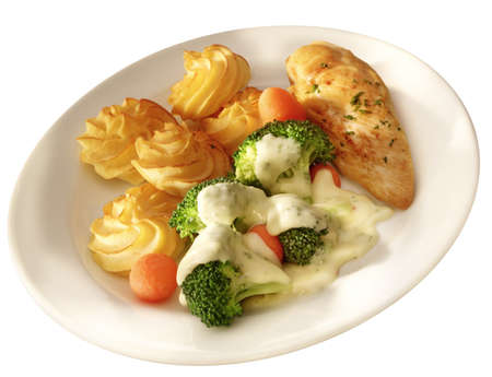 pome: chicken brest on a plate with pome duchesse and vegetabeles Stock Photo