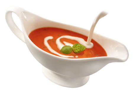 cut out sauce boat on white background cream pouring in photo