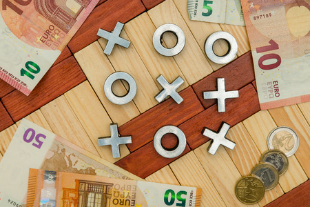 Gambling for money, Cross and zero game, euro coins, euro notes, money games