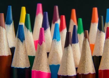 Close up of an assortment of colour pencils on black background. School supplies, creativity concept 免版税图像