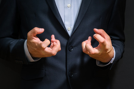 Business man fists clenched in anger. Annoying emotions at work