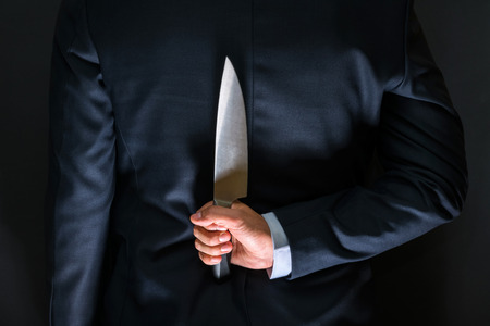 Robber with big knife - a killer person with sharp knife about to commit a homicide, murder scenery Stock Photo
