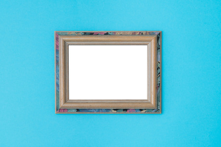 Blank empty vintage wooden frames on blue background. Art gallery, museum exhibition white clipping path