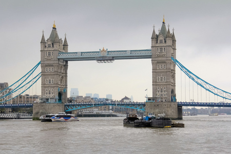 View of tower bridge in London, England with cloudy grey sky