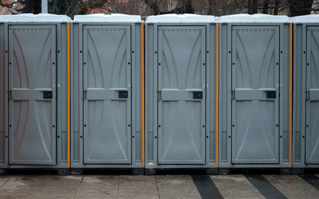 Long row of mobile toilets outside in the city. Bio toilets outdoors Reklamní fotografie
