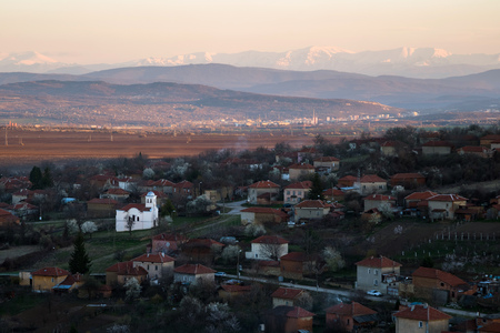 Scenic view of Slavyani village church with Lovech city in the background. Balkan mountain range in Bulgaria, evening light