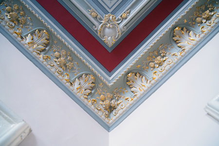 Stucco and luxurious decorative elements on ceiling. Luxury aesthetic in a modern home decor Reklamní fotografie