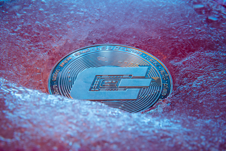 Silver Dash coin, online digital currency frozen in the blue ice. Concept of block chain, crypto market crash. Frozen crypto money, depreciation Reklamní fotografie