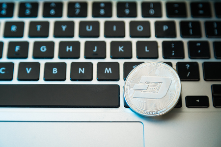 Circle Dash coin on top of computer keyboard buttons. Digital currency, block chain market, online business Stock Photo