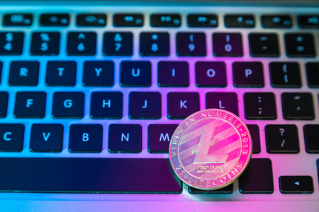 Circle Litecoin, lite coin on top of computer keyboard buttons. Digital currency, block chain market, online business Stock Photo