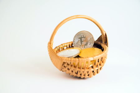 Circle Bitcoin coin in the wicker basket on white background. Digital currency, block chain market, online business Stock Photo - 124898545
