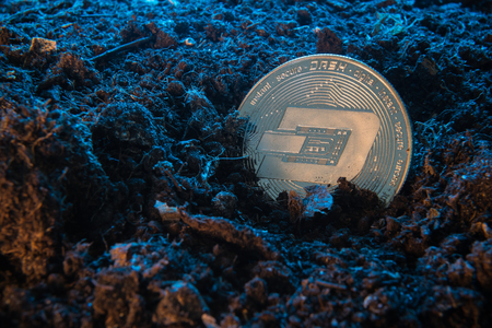 Mining crypto currency - Dash coin. Online money coin in the dirt ground. Digital currency, block chain market, online business