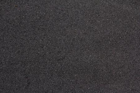 Tekstura asfaltu ulicy. Szorstki tło powierzchni drogi. Abstrakcyjny wzór chodnika