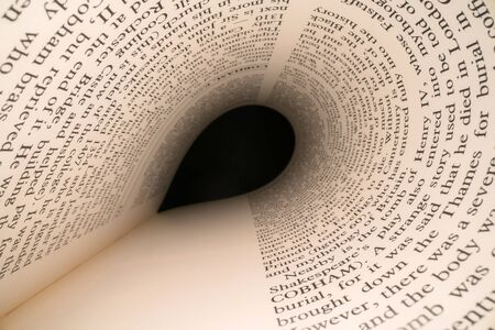 Inside the book concept. Latin letters and words on an tunnel shaped, perspective book page with black dramatic light. Education, knowledge concept Banco de Imagens