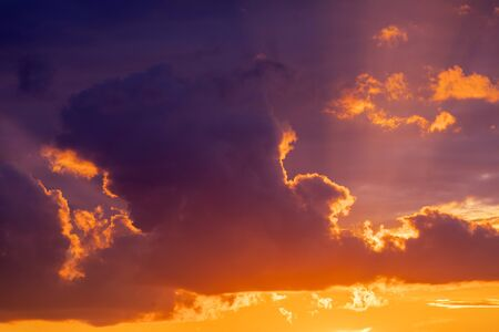 Dramatic sunset sky panorama with burning colourful clouds background. Idyllic cloudscape backdrop at dawn. Majestic cloud scenery Banco de Imagens