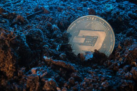 Mining crypto currency - Dash coin. Online money coin in the dirt ground. Digital currency, block chain market, online business Banco de Imagens - 128823201