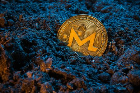Mining crypto currency - Monerd. Online money coin in the dirt ground. Digital currency, block chain market, online business Banco de Imagens - 128823202