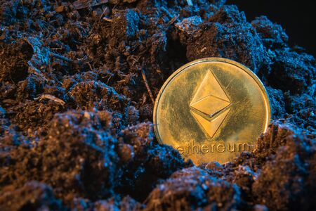 Mining crypto currency - Ethereum. Online money coin in the dirt ground. Digital currency, block chain market, online business