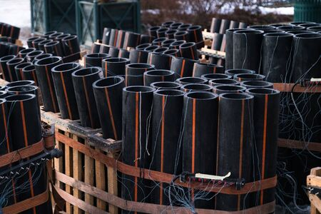 Preparation of big firework show with tubes filled with gunpowder and electric wire on ground. Fireworks festival, entertainment, danger.