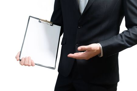 young business man wearing a suit while holding sign board, clipping path, space for text