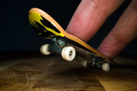 Fingerboard. A small skateboard for kids and teenagers to play with hand fingers. Youth culture, extreme sport Reklamní fotografie