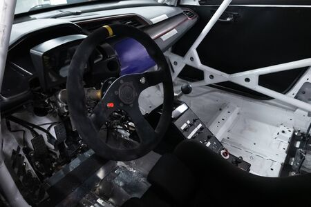 Sports car steering wheel. Driving wheel inside competitive vehicle. Car interior view