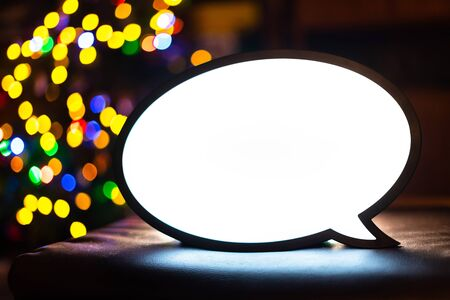 Empty lightbox sign with colourful bokeh balls in the background. Blank light box screen for adds, promotion, business advertising messages. Bright chat lamp with white screen for text Banco de Imagens