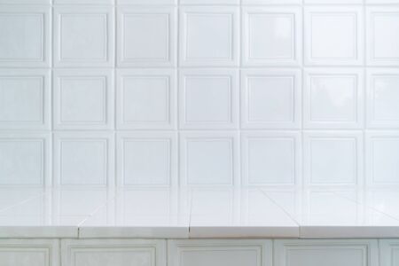White ceramic oven tile background. Table like surface of vintage square bricks. Bright, modern interior design, brick pattern