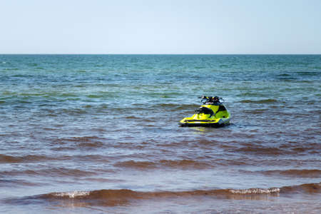 Water jet ski at the blue sea shore on a sunny day with copy space for text. Nobody.