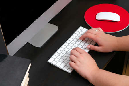 Close up of hands typing keyboard and using mouse at the office. Concept of education and working on computer. 스톡 콘텐츠